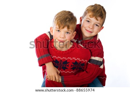Two handsome young boys happy and playful. - stock photo