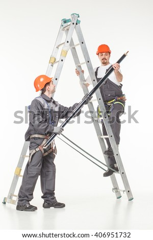 Two handymen at work stair white background - stock photo
