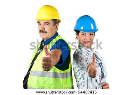 Two happy architects with hardhat standing back to back and giving thumbs -up isolated on white background - stock photo