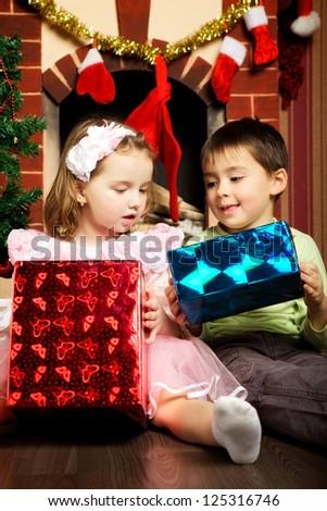 two happy beautiful child near christmas tree - stock photo