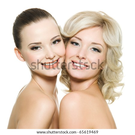 Two happy beautiful women posing together - isolated on white - stock photo