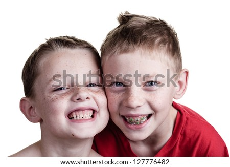 Two happy brothers share a laugh