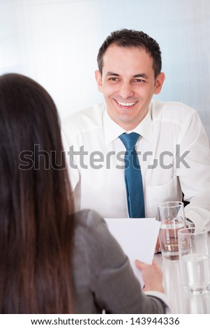 Two Happy Business People In The Meeting - stock photo