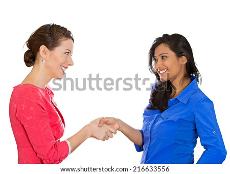 Two happy business women shaking hands, after conflict resolution, finding solution to problem, isolated white background. Positive human emotions, facial expressions, attitude - stock photo