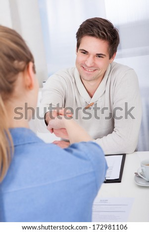 Two Happy Businesspeople Shaking Hand With Each Other - stock photo