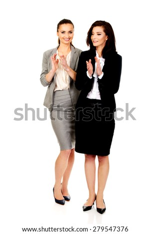 Two happy cheerful businesswomen applauding. - stock photo