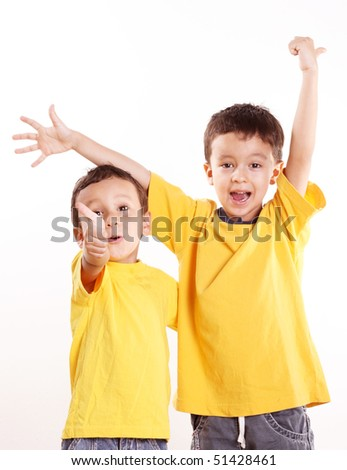 Two happy children over white background. Isolated image