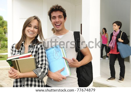 Two happy college or university students smiling - stock photo