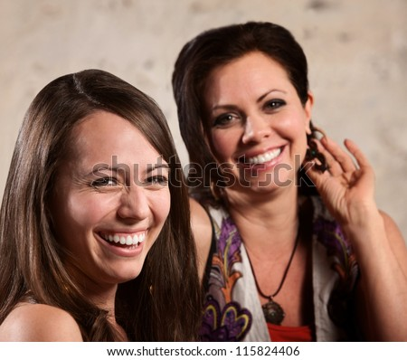 Two happy European females next to each other laughing - stock photo