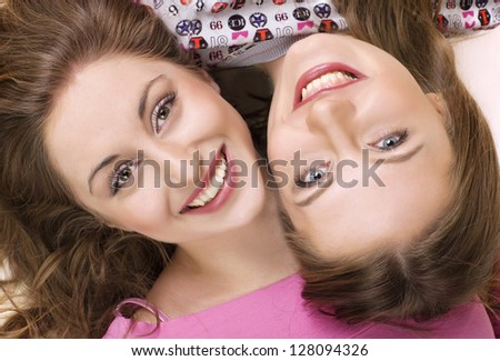 Two happy girls friends. over white background.
