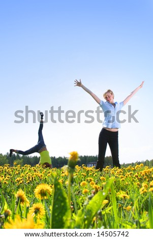 two happy girls having fun outdoors - stock photo