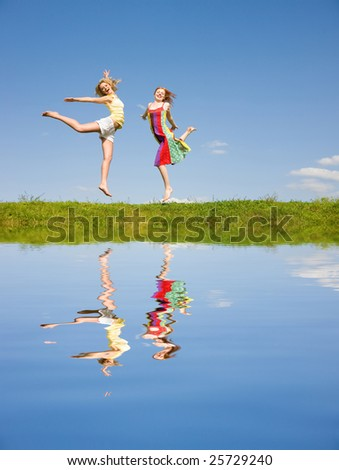 Two happy girls jumping - stock photo