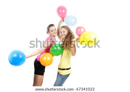 two happy girls with balloons over white