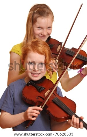 Two happy girls with violins isolated on white background - stock photo