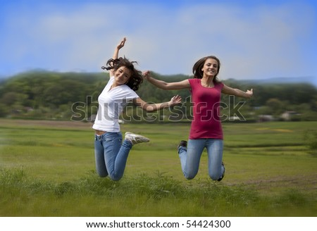 Two happy jumping girls - stock photo