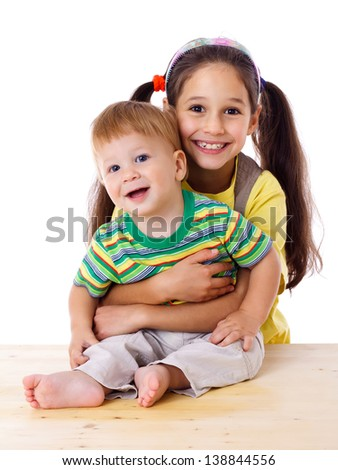 Two happy kids hugging together, isolated on white - stock photo