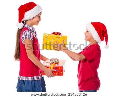 Two happy kids presenting with a Christmas gift boxes to each other, isolated on white - stock photo