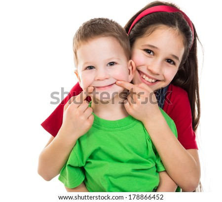 Two happy kids together, isolated on white - stock photo