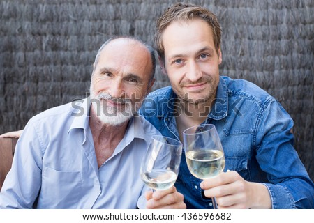 Two happy male generations together - stock photo