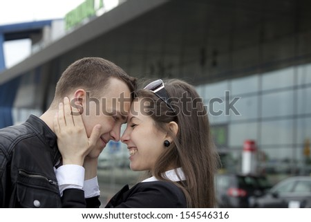 Two happy people at the airport  - stock photo