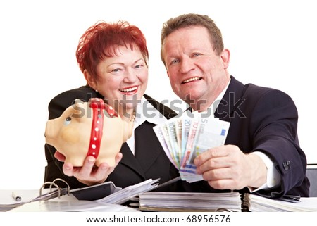 Two happy seniors offering Euro money and piggy bank - stock photo