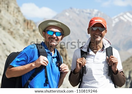 Two happy smiling tourist traveller hiker in india Himalayas mountains