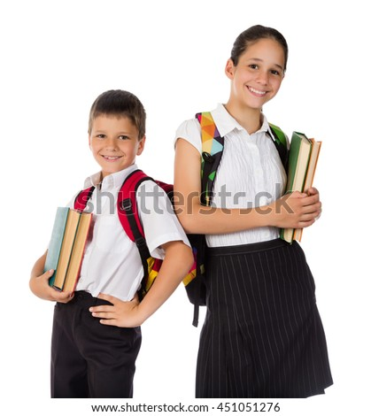 Two happy students standing with books in hands, isolated on white