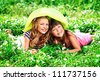 Two happy summer girls having fun outdoors. - stock photo