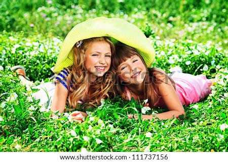 Two happy summer girls having fun outdoors.