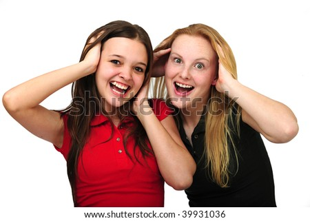 two happy surprised women isolated on white
