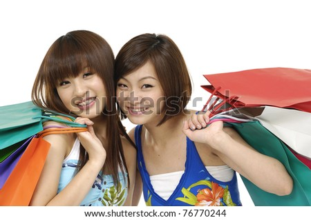 Two happy teenage girls on a shopping - stock photo