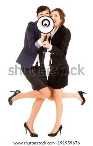 two happy young business women with megephone, white background - stock photo