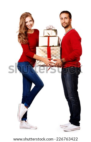 Two happy young people in love give each other gifts. Isolated over white. - stock photo