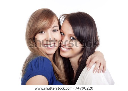 two happy young women standing, smiling - isolated on white