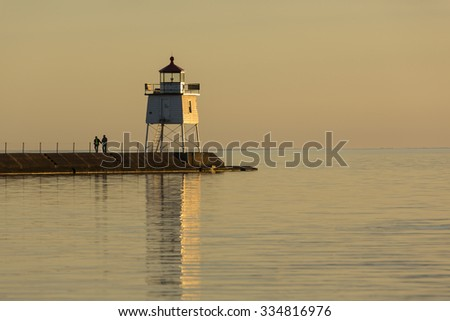 Two Harbors Pier Lighthouse At Sunset - stock photo