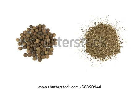 Two heaps of black pepper isolated on white - stock photo