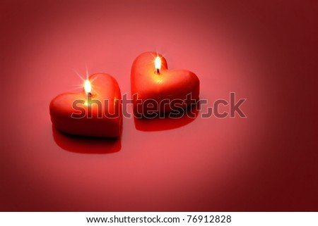 two heart-shaped candles - stock photo