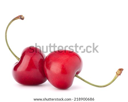 Two heart shaped cherry berries isolated on white background cutout - stock photo