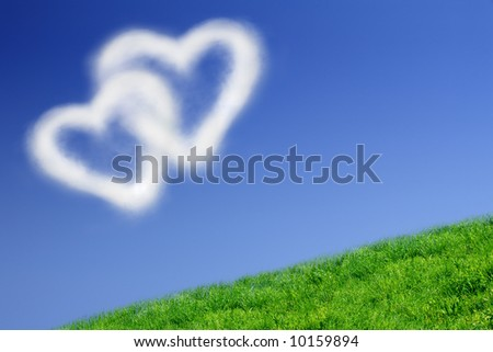 Two heart-shaped clouds in the clear blue sky - stock photo