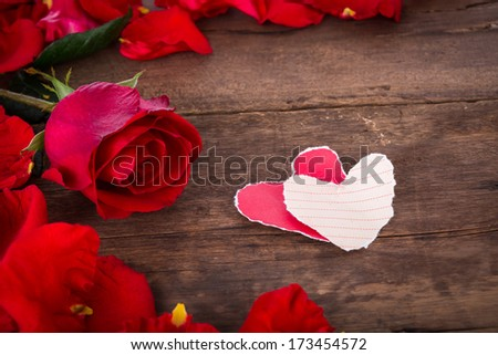 Two Heart shaped paper  on wood with decoration of red rose - valentine  background