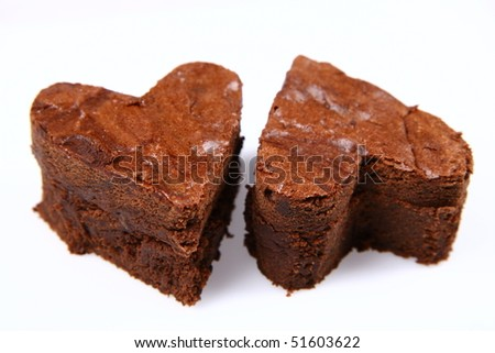 Two heart shaped slices of a brownie on white background - stock photo