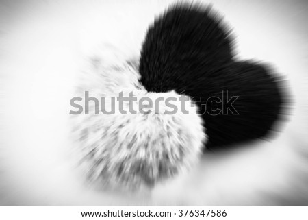 Two hearts black and white ,Blurred love concept - stock photo