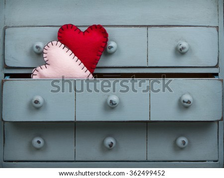 Two hearts inside a drawer in a dresser or chest - stock photo