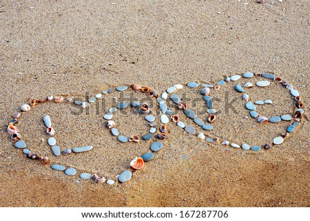 two hearts of stones on the sea sand - stock photo