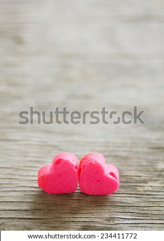 Two hearts on a wooden background on Valentine's Day.