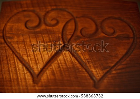 Two hearts on a wooden table. Background