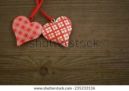 two hearts on old wooden background - stock photo