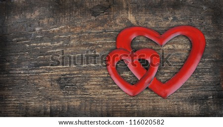 Two hearts on wooden texture