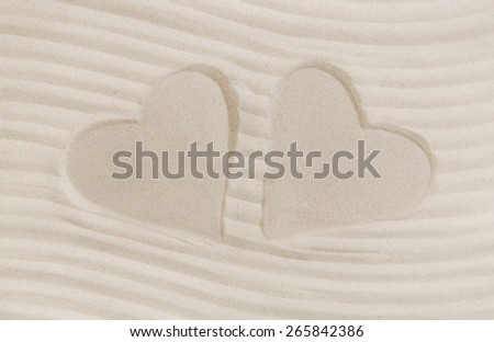 Two hearts print in the white sand. Summer beach and vacation concept for a background. - stock photo