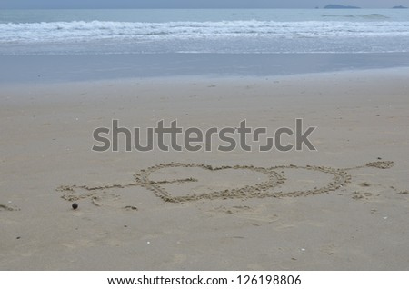 Two hearts wrote on sand